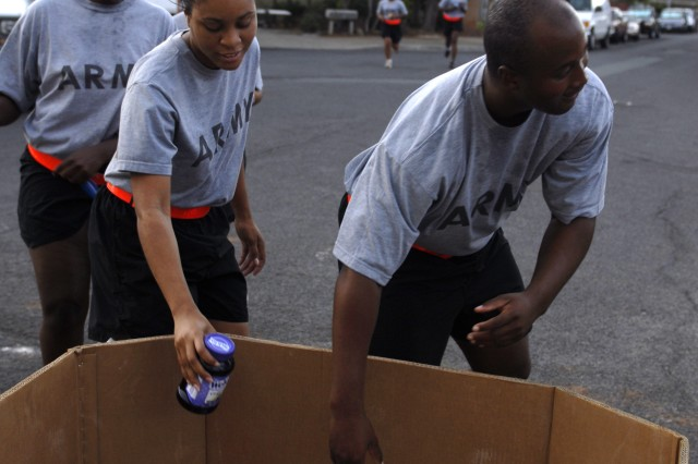 HONOLULU, Hawaii (November 19, 2008) - Spc. LaQuan Burt, Spc. Anita Pascal, and Spc. Terra Bell, all from U.S. Army, Pacific, Special Troops Battalion, drop cans of food for charity during the battalion's Good Samaritan Run, an annual run sponsored by the USARPAC chaplains' office.