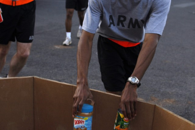 HONOLULU, Hawaii (November 19, 2008)- Cpt. Jim Brockington, U.S. Army, Pacific Special Troops Battalion company commander, joins USARPAC Soldiers during a 4 mile Good Samaritan Run, in which participants drop nonperishable food items off as donations to charity (photo by Staff Sgt. Crista Yazzie, USARPAC Public Affairs).