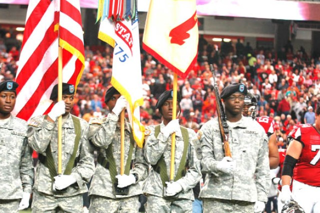The Fort McPherson U.S. Army Forces Command color guard team presents the flags as the national anthem plays at Sunday's pre-game ceremony for the Atlanta Falcons versus Denver Broncos game held at the Georgia Dome. The team is comprised of, from left, Staff Sgt. Kimberly Nicholas, rifleman; Sgt. 1st Class Calvin Hood, national colors bearer and NCO in charge; Sgt. 1st Class Richard Tulloch, Army flag bearer; Staff Sgt. Kelly Henderson, Installation Management Command-Southeast Region, flag bearer; and Sgt. Timothy Braswell, rifleman.