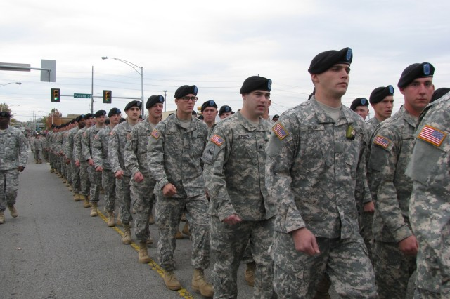 Soldiers from the 59th Ordnance Brigade march along the parade route during the Veterans Day Parade in downtown Huntsville. Crowds cheered the loudest when the Soldiers marched by the reviewing stand.