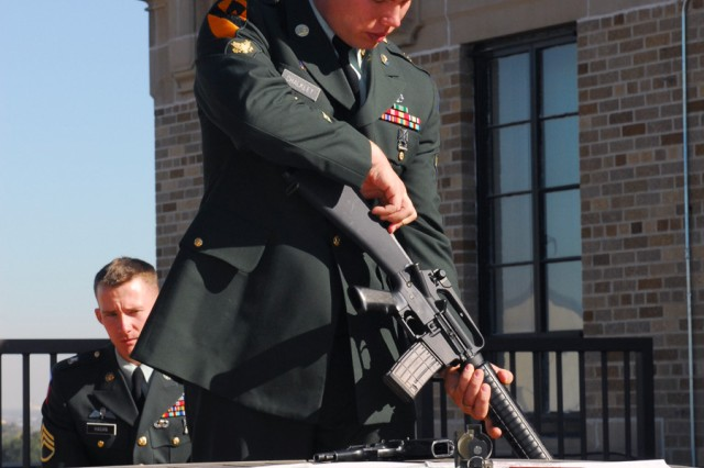 Spc. James Chalkley demonstrates his expertise with the M-4 rifle in front of the formal board for the U.S. Army South Second Quarter Soldier competition held here Nov. 19. Chalkley won the competition.