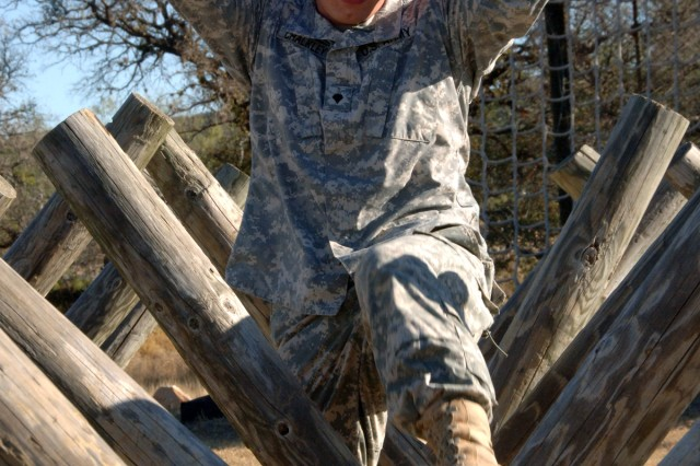 Spc. James Chalkley traverses the Camp Bullis obstacle course. Chalkley was named the winner of the U.S. Army South Second Quarter Soldier competition held here Nov. 18.