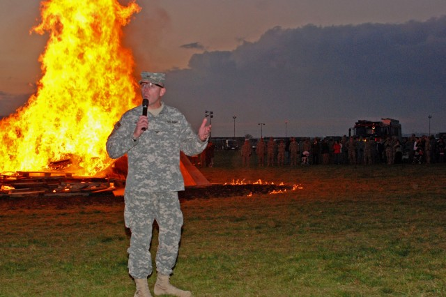 Col. Jeffrey A. Sinclair, 172nd Infantry Brigade commander, addresses brigade Soldiers and Families during the bonfire finale of the 'Blackhawk Rendezvous' in Schweinfurt, Germany, Nov. 13.