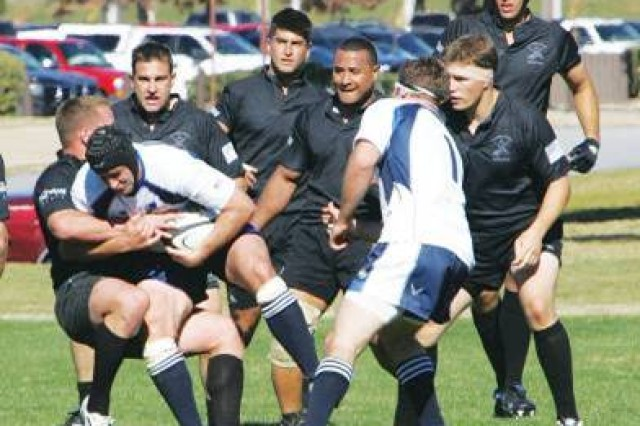Members of the Army rugby team gang tackle an Air Force player during the opening round of the 2008 Armed Forces Rugby Championships.  The Air Force went on to win the championship with a 37-8 win over the Navy.