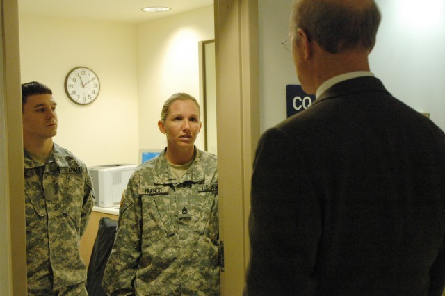 Secretary of the Army Pete Geren talks with Staff Sgt. Charity Franco a Fort Richardson Warrior Transition Unit cadre member. Geren visited Fort Richardson as a part of Warrior Care Month. During his time in Alaska the secretary talked with wounded warriors and toured the barracks where they live while recovering from their injuries.