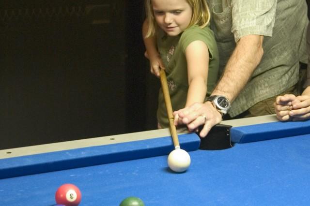 Dad teaches pool