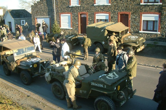 Like last year's gathering in Bastogne, the historical walk attracts a flurry of activity by vintage vehicles, equipment and re-enactors in period uniforms. Money raised by the annual walk supports Veterans organizations.