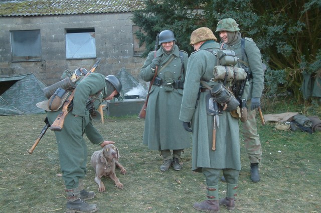 German re-enactors at the 2007 annual walk. Re-enactors portraying all sides of the siege on Bastogne participate in the annual walk and with hundreds of modern day Soldiers one can see military members from many nations share a peaceful day of conciliation and remembrance.