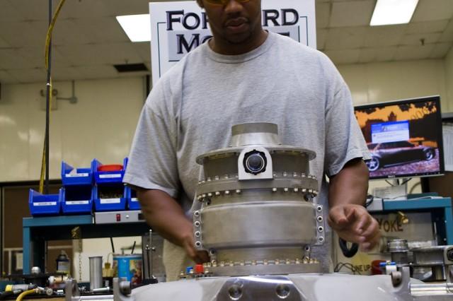 Harrow Miller assembles a turbine engine forward module.