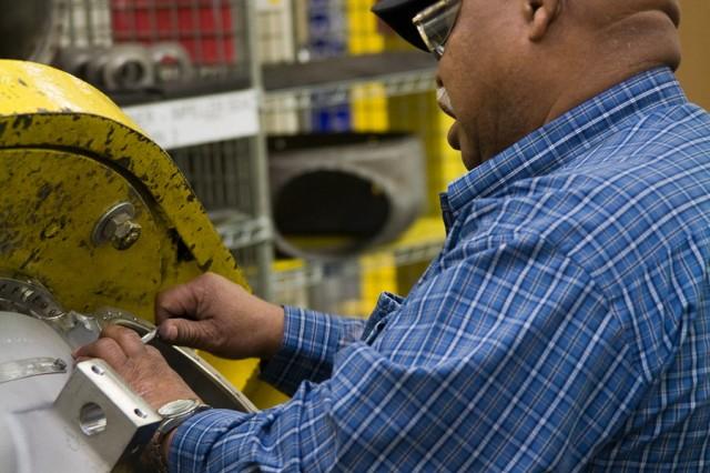 Hubbard Calhoun inspects a turbine engine forward module.