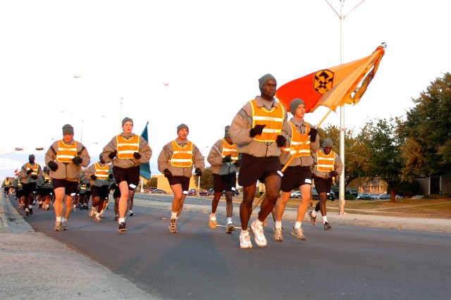 Command Sgt. Maj. Nathaniel Bartee Sr., the senior noncommissioned officer for the 15th Sustainment Brigade, 13th Sustainment Command (Expeditionary), leads the brigade's NCOs on a brisk four-mile run Nov. 21 to build esprit de corps and get their day started right.