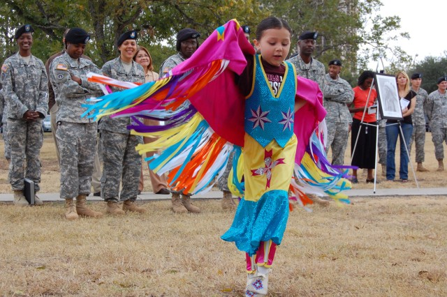 Cheyenne Hoskins performs a traditional Native American dance in front of a crowd of Soldiers here Nov. 14 as part a National Native American Indian Heritage Month celebration hosted by U.S. Army South. Featured guests included the Great Promise for American Indians, a Kiowa Tribe out of Austin, Texas, who performed Native American dances in their traditional regalia and the Eagle Point Drum, who provided live Native American music.