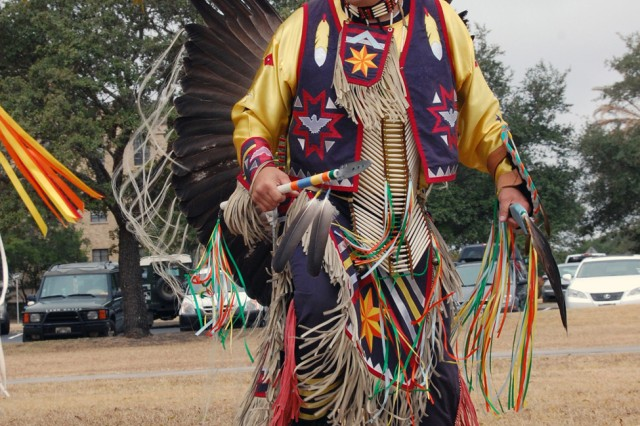 David Hoskins performs a traditional Native American dance for the crowd. Hoskins is part of the Great Promise for American Indians, a Kiowa Tribe out of Austin, Texas. U.S. Army South hosted a National Native American Indian Heritage Month celebration in front of the headquarters Nov. 14.