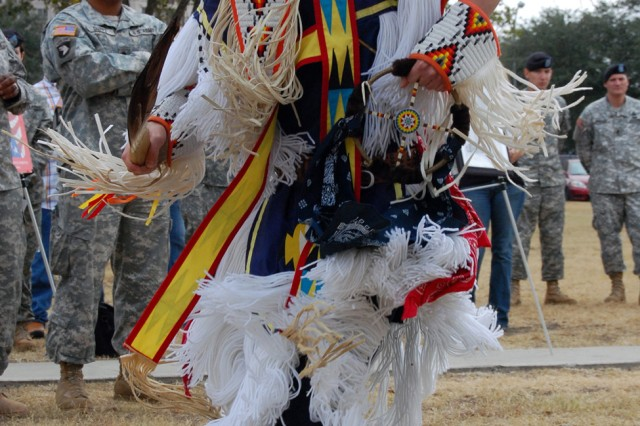 Chayton Hoskins performs a traditional Native American dance in front of a crowd of Soldiers here Nov. 14 as part a National Native American Indian Heritage Month celebration hosted by U.S. Army South.. Featured guests included the Great Promise for American Indians, a Kiowa Tribe out of Austin, Texas, who performed Native American dances in their traditional regalia and the Eagle Point Drum, who provided live Native American music.
