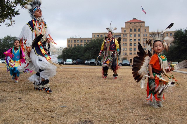 Left to Right: Cheyenne Hoskins, Clayton Bass, David Hoskins and Chayton Hoskins perform Native American dances in their traditional regalia in front of the U.S. Army South headquarters here Nov. 14. Featured guests included the Great Promise for American Indians, a Kiowa Tribe out of Austin, Texas, who performed Native American dances in their traditional regalia and the Eagle Point Drum, who provided live Native American music.