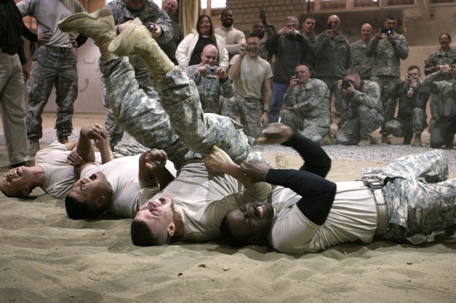 Soldiers assigned to the 10th Mountain Division feel the effects of a Taser during non-lethal weapons training on Fort Drum, N.Y., Nov. 19, 2008.