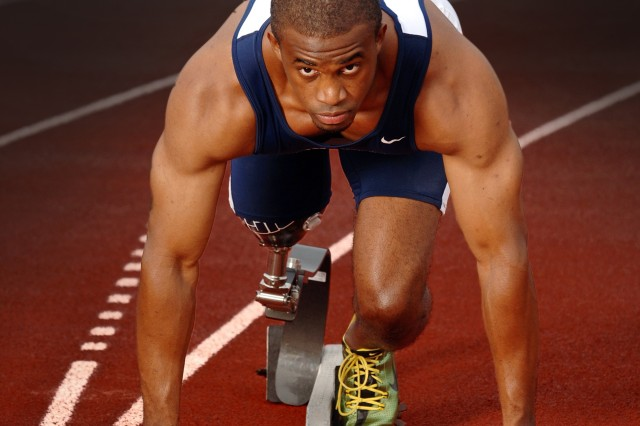 """After losing his leg to an IED while saving a Soldier in Baghdad during the spring of 2005, Kortney Clemons earned his degree in therapeutic recreation at Penn State. His book, """"Amped,"""" was published June 2008."""