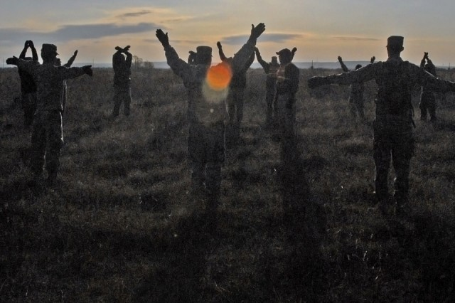 Soldiers review hand and arm signals used to guide helicopters during a Sling Load Certification Course conducted by 15th Sustainment Brigade here, Nov. 21.