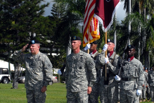FORT SHAFTER, Hawaii -- (Nov. 25, 2008)  Lt. Col. Chadwick A. Bowers salutes after he and Sgt. Maj. Timothy Shelton uncase the colors during an activation ceremony for the 18th Medical Command (Deployment Support) held here on historic Palm Circle.  The unit will serve as the Medical Theater Enabling Command for United States Army, Pacific and provide command and control, administrative assistance and technical supervision for all assigned and attached medical units in the Pacific Command Area of Responsibility.