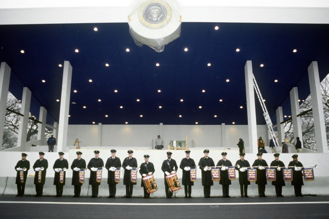 The U.S. Army Herald Trumpets practice in front of the presidential reviewing stand at Fort Myer, Va., Jan. 10, 1993, in preparation for the presidential inauguration.
