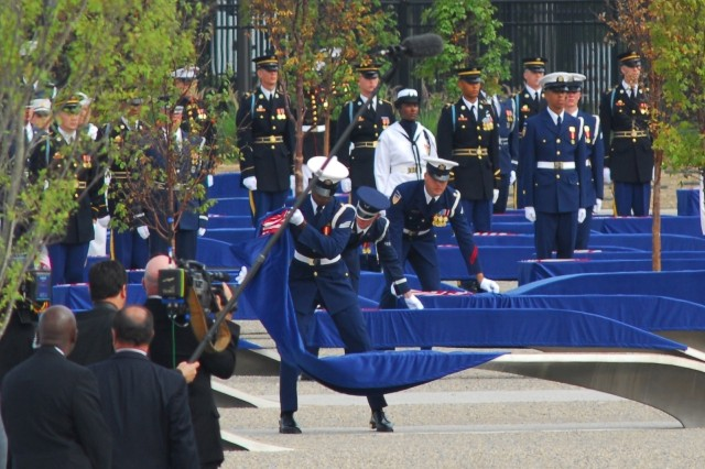 Servicemembers unveil the engraved benches dedicated to the 184 who lost their lives at the Pentagon on Sept. 11, 2001.