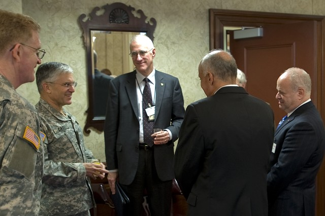 "From left to right, LTG Eric Schoomaker, Army Surgeon General, GEN. George W. Casey Jr., Chief of Staff of the Army, Dr. Michael Matthews, West Point professor, Dr. Richard Cormona, former Surgeon General of the U.S., and Dr. Martin Seligman, former president of the American Psychology, talk before having a roundtable discussion about improving Warrior Care and health literacy within the Army at the Pentagon, Washington D.C., Nov. 25, 2008. ""I very much appreciated the conversation, and I hope we can continue the dialogue,"" said Gen. Casey at the conclusion of the meeting."