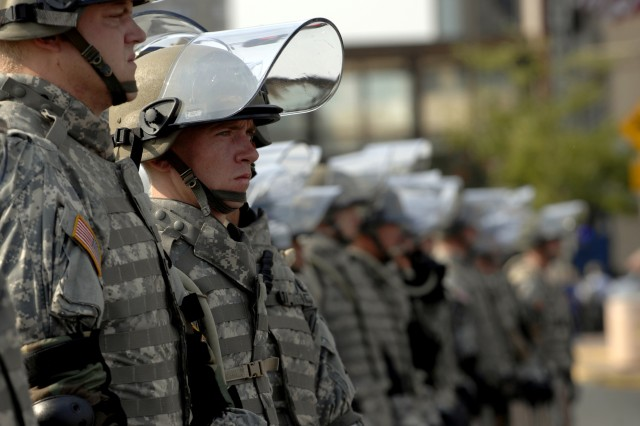 Minnesota National Guard Soldiers with the 1st Combined Arms Battalion, 194th Armor stand guard to assist St. Paul Police in maintaining order during an overly-aggressive demonstration Sept. 1, 2008, in St. Paul, Minn. The demonstrators were protesting during day one of the Republican National Convention.