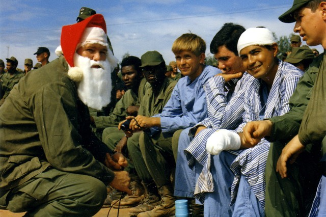 "Vietnam, 1970-""Santa Claus"" talks with a group of hospital patients during the Bob Hope Christmas Show."