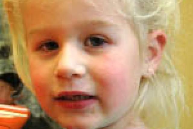 """My toys.""Jillian Loftis, 4, daughter of Lt. Col. Stephen Loftis, an aviator for U.S. Army Central, G-3, Fort McPherson, Ga."