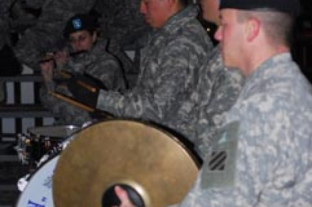 Third Infantry Division Band members Sgt. Ted Dipietro, Spc. Eisner Gaitan, and Pfc. Alan Bradley play percussion instruments for attendees at the 4th BCT welcome home ceremony Nov. 23 on Cottell Field.