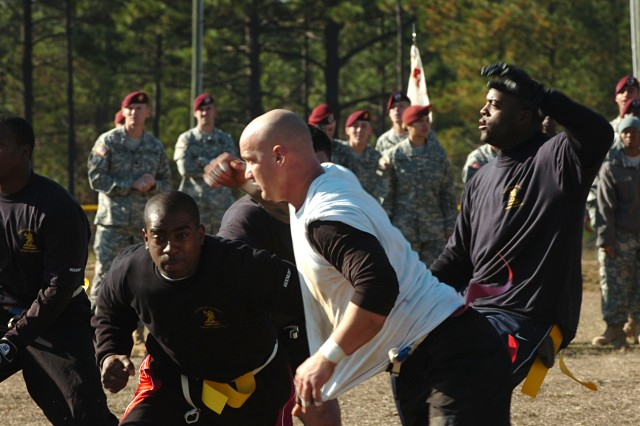 "Paratroopers from the 82nd Airborne Division's 2nd Brigade Combat Team compete in the annual ""Turkey Bowl"" Thanksgiving flag football game at Fort Bragg, NC Nov. 26. This year's contest pitted the ""Golden Griffins"" of the 407th Support Battalion against the ""White Falcons"" of the 2nd Battalion, 325th Airborne Infantry Regiment. The White Falcons won the game and earned the coveted Turkey Bowl Cup."