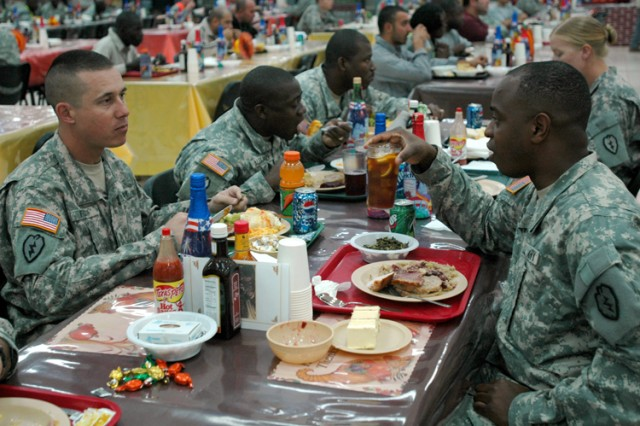 Chief Warrant Officer 3 Willie Taylor (right) of 3rd Brigade, 25th Infantry Division, dines at Contingency Operating Base Speicher, Iraq's North Dining Facility with members of his unit, Sgt. 1st Class Darrin Fox, (left) and Sgt. 1st Class Leroy Alexander (center), Nov. 27. Soldiers from the 25th Infantry Division are currently awaiting a change of authority over the Salah Ad Din province from the 1st Armored Division at the beginning of the year.