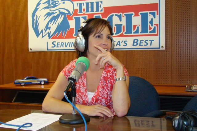 """Laura Knarr, who is part of the New Parent Support Program team at U.S. Army Garrison Hohenfels, Germany, prepares for a call-in radio program she co-hosts once a month called """"Instructions Not Included."""""""