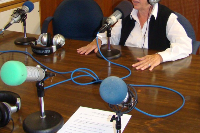 """Priscilla Fleischer answers a question during """"Instructions Not Included,"""" a call-in radio program broadcast every first Tuesday of the month for parents at U.S. Army Garrison Hohenfels, Germany."""