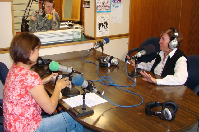 """Laura Knarr, left, and Priscilla Fleischer, along with radio host Spc. Nathan Jones, respond to a listener's question during """"Instructions Not Included,"""" a call-in radio program broadcast every first Tuesday of the month for parents at U.S. Army Garrison Hohenfels, Germany. Knarr and Fleischer are New Parent Support Program specialists who started the show to allow a large audience of parents to call in with questions."""
