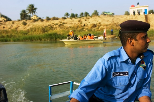 An Iraqi policeman steers his boat away from the bank as a second boat follows during a combined patrol on the Tigris River in al Kut, Nov. 24.