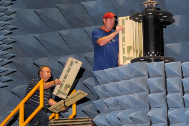 Left, David Stutzman and Mark Dolph, LCMR technicians, set up a AN/TPQ-48 for testing in the simulator's anachoic chamber.