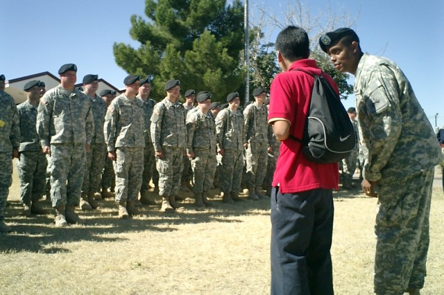 First Sgt. Douglas Merritt helps instruct MacArthur students on the proper way to lead a company-size formation in drill and ceremony Oct. 24.