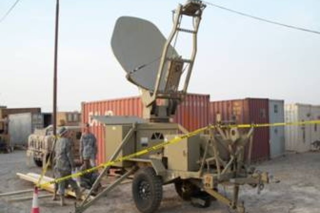 Sgt. 1st Class Clifton Norrid from Alvarado, Texas, and Sgt. Frank Giger from Kansas City, Mo., carefully observe a CPN satellite terminal trailer set up after being transported there by supporting units of the 297th Inland Cargo Transfer Company, 398th Combat Sustainment Support Battalion, 1st Sustainment Brigade. Norrid is a platoon sergeant, and Giger is a command post node team chief. Both soldiers are deployed with Signal Company, Special Troops Battalion, 1st Sustainment Brigade in support of Multi-National Division - Baghdad.