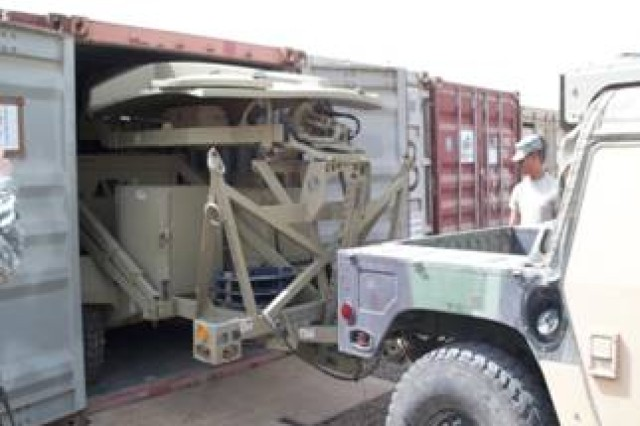 Spc. Ulysses Gerena, from Pembroke Pines, Fla., supervises the packing up the satellite terminal trailer, so the Centralized Receiving and Shipping Point can transport it to another forwarding operating base. Gerena is deployed with Signal Company, Special Troops Battalion, 1st Sustainment Brigade in support of Multi-National Division - Baghdad.