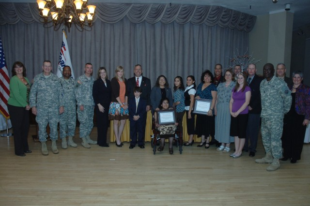 Fort Bliss families were chosen for their volunteer contribution within the community during the Fort Bliss Volunteer Family Recognition Ceremony Nov. 13 at the Officers' Club.