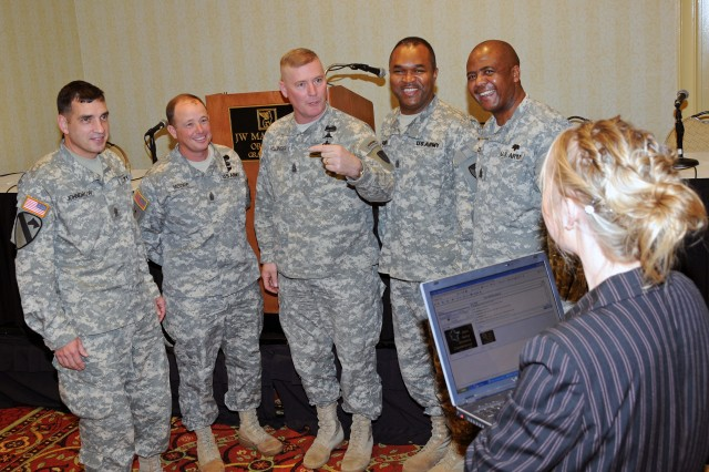 Five command sergeants major made history Dec. 1 when the 26th Army Science Conference broadcast its press conference live at blogtalkradio.com for the first time. Lindy Kyzer orchestrates the online event from her laptop. From left, Command Sgt. Maj. Philip F. Johndrow, U.S. Army Combat Arms Center; Command Sgt. Maj. Robert A. Moore, U.S. Army National Training Center; Command Sgt. Maj. Jeffrey J. Mellinger, U.S. Army Materiel Command; Command Sgt. Maj. Hector G. Marin, U.S. Army Research, Development and Engineering Command; and Command Sgt. Maj. James E. Diggs, HQS, North Atlantic Regional Medical Command.