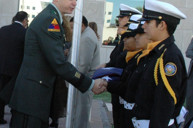 Brig. Gen. Sean MacFarland, commanding officer of Joint Task Force North, shakes hands with members of the Socorro High School Navy Junior Reserve Officer Training Corps during the grand opening ceremony of the U.S. Consulate General in Ciudad Juarez, Mexico.