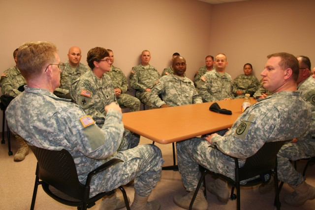 Army Surgeon General Lt. Gen. Eric B. Schoomaker speaks with several Fort Campbell Warrior Transition Unit Cadre during his visit there Nov. 24. Schoomaker advised cadre to help their Soldiers by using common sense instincts and doing what is right for each of their warriors in transition.
