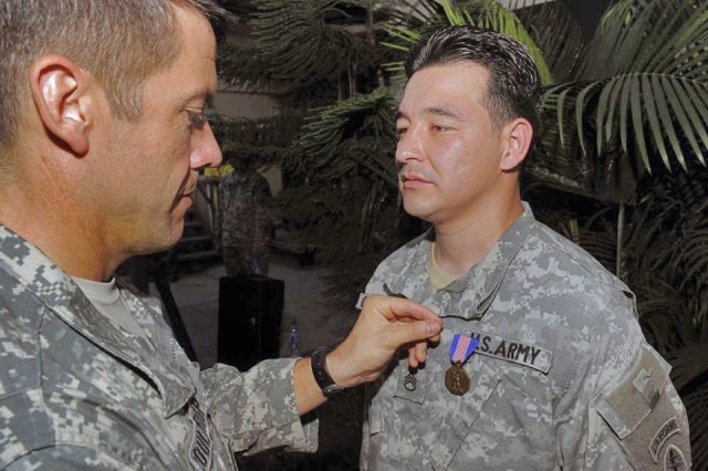 Colonel Bill Coultrup, Joint Special Operations Task Force-Philippines Commander, pins the Soldier's Medal on Staff Sergeant Ruben D. Gonzalez as part of a formal ceremony held on Thanksgiving Day, 27 November 2007.  Gonzalez was awarded the medal for risking his life to save three Philippines students from drowning.  (Photo by MC2 Aaron D. Burden, JSOTF-P)