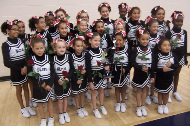 Team Bliss Cheerleaders with their first place trophy from the Rio Rancho, N.M., Nov 15. Back row, left to right: Yasmine, Abril, Alyssa, Karryssa, Kelsey, Payton, Lindsey, Kerstin, Tia' and Selena,  Middle row: Maddie, Alyssa, Sarah, Angie, Ali and R'Noda,  Front row: Katie, Emily, Sophia, Jordan, Denise, Jordan and Christina.