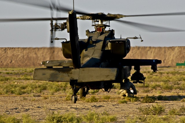 Spc. Rogelio Rodriguez, armament avionic electronic technician, Company D, 4th Battalion, 4th Aviation Regiment, Combat Aviation Brigade, 4th Infantry Division, Multi-National Division - Baghdad, checks the weapons systems on a AH-64D Apache attack helicopter during a training exercise on Camp Taji, Nov. 24.