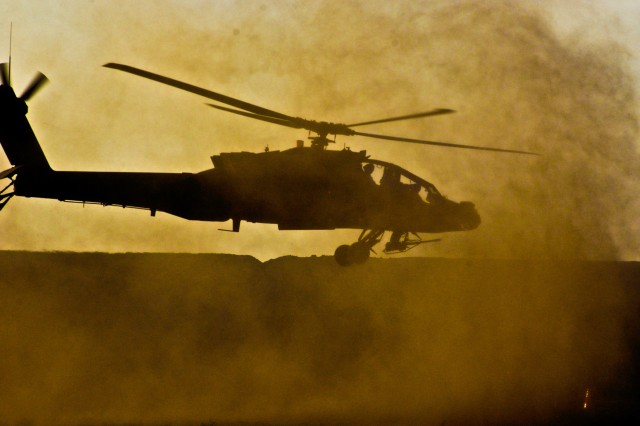 An AH-64D Apache attack helicopter from the Combat Aviation Brigade, 4th Infantry Division, Multi-National Division - Baghdad, departs after being refueled by an Advanced Aviation Forward Area Refueling System during a training exercise at Camp Taji, Nov. 24.
