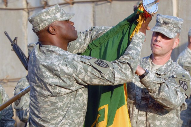 Col. Mark Spindler, commander of U.S. Army Europe's 18th Military Police Brigade (right), and brigade Command Sgt. Maj. Bernard McPherson case the 18th's colors as the unit transfers its Police Transition Team mission to the 8th Military Police Brigade at Camp Liberty, Iraq, Dec. 1. The 18th will return to its home station in Mannheim, Germany in the coming weeks as it concludes its 15-month deployment.