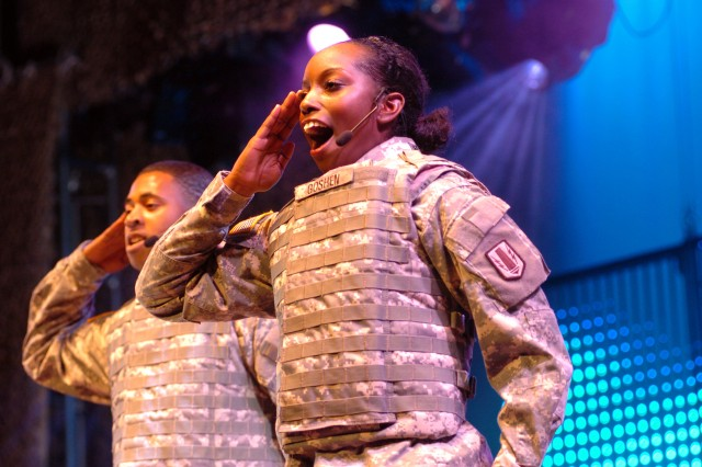 """Pfc. Jokia Goshen of Fort Hood, Texas, and Sgt. Kevin Lynum of Fort Carson, Colo., salute while singing Myron Butler's """"Stronger"""" during the 2008 U.S. Army Soldier Show."""